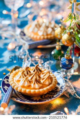 Mini orange curd and meringue tartlets for holiday - stock photo