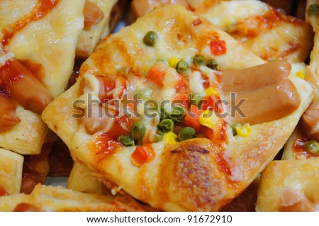 mini pizza with sauce and sausage