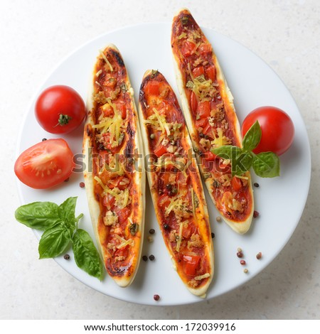 mini pizza with tofu, tomato and soy cheese - stock photo