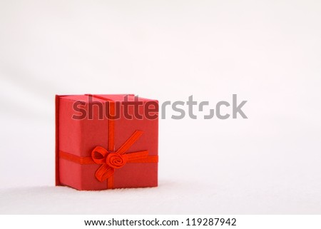 Mini red gift box on soft background