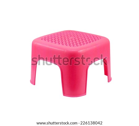 Mini red plastic stool on white background