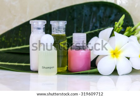 mini set of bubble bath and shower in bathroom with flower decorated - stock photo