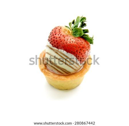 Mini strawberry tart on white background - stock photo