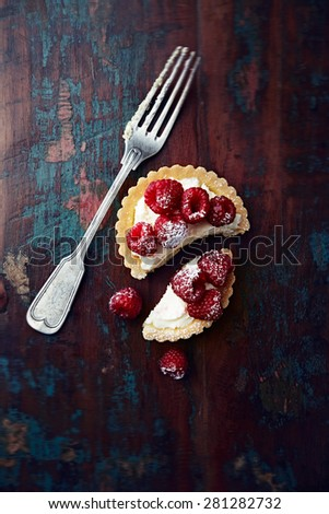 Mini tart with mascarpone and raspberries - stock photo