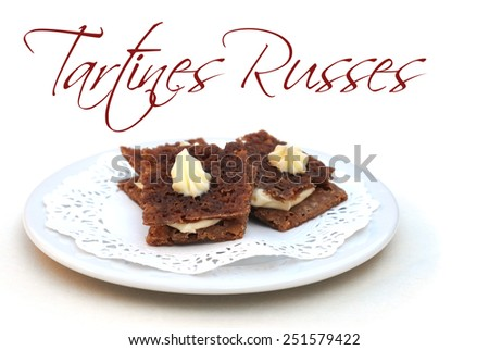 Mini tartines-russes on plate, on white, with easy removable French text Tartines Russes meaning russian sandwich, shallow dof - stock photo