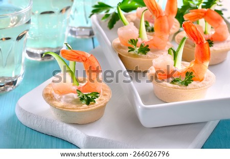 Mini tartlets with shrimps, delicious party appetizer - stock photo