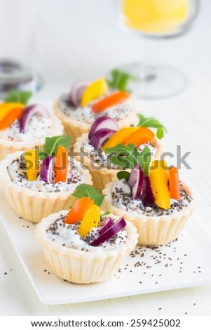 Mini tarts with  soft cheese and chia seeds for holiday, selective focus - stock photo