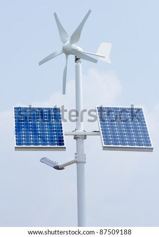 Mini wind power and solar panels for domestic use - stock photo