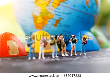 Miniature backpacker on map with globe and tent bed Concept of Travel around the world & Miniature Backpacker On Map Globe Tent Stock Photo 689017228 ...