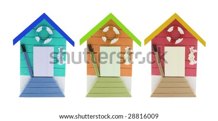 Miniature Beach Houses on Isolated White Background - stock photo
