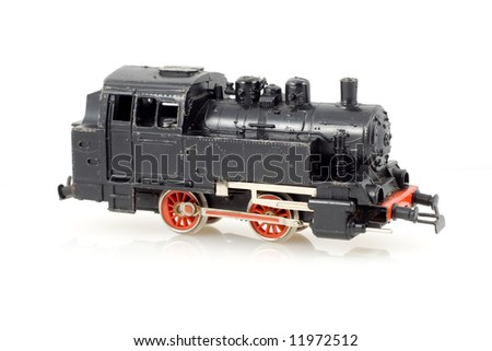 Miniature black locomotive on a white - stock photo