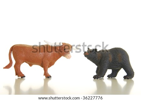 Miniature bull and bear photographed on white symbolizing financial markets - stock photo