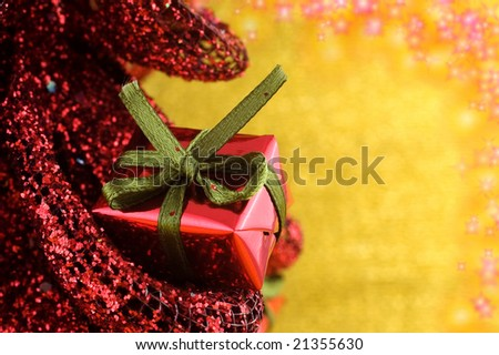 Miniature Christmas present with shallow depth of field  and glittering stars. Copy space