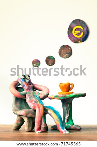 Miniature clay man sitting in cafe dreamin about wealth - stock photo