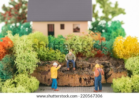 Miniature construction workers getting ready to renovate the house - stock photo