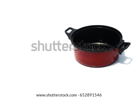 Miniature cooking pot isolated on white background with copy space.