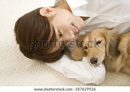Miniature dachshund and woman