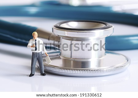 Miniature doctor - stock photo