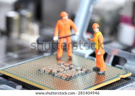 Miniature engineer or technician repairing CPU , Technology concept - stock photo