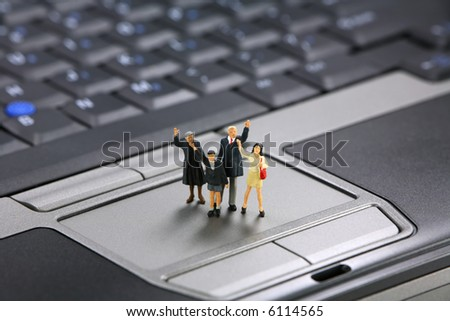 Miniature family waves for help with their laptop computer. Tech support concept. - stock photo