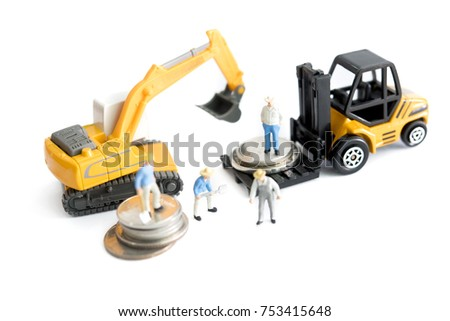 Miniature Figure Of Workers And Construction Equipment Vehicle In White Background