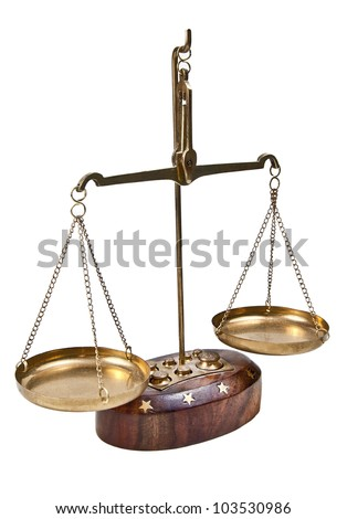 Miniature golden scale with weights on white background - stock photo