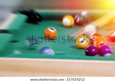 Miniature green billiard (pool) table. Post processed with radial blur zoom effect.