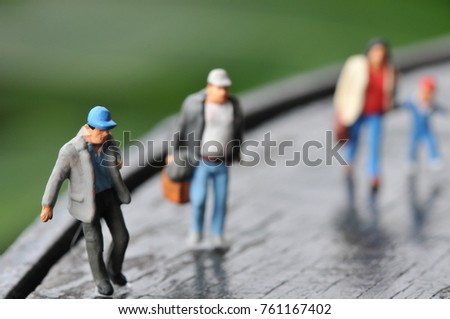 Miniature group of peoples with traveling concepts, Small hiker figure walking with backpack. Peoples stay walking together. Peoples relationship conceptual.