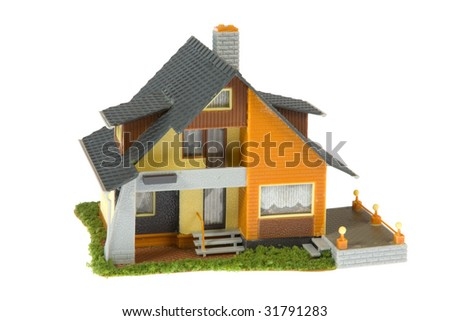 Miniature house isolated on white background