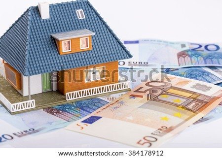miniature house model on euro money banknotes. real estate industry concept - stock photo