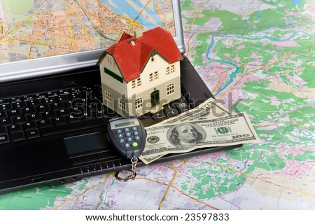 Miniature House on Money. Part of Series. See Portfolio For Similar Images - stock photo