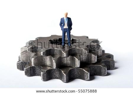 miniature man on gears - stock photo