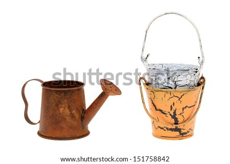 miniature metal watering can and bucket isolated on white background - stock photo