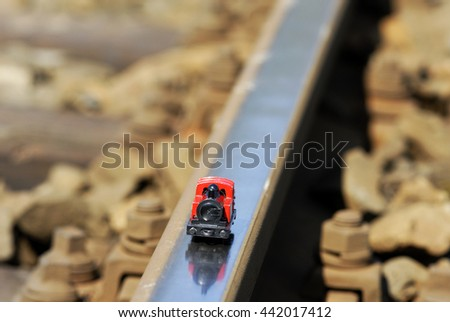 Miniature model of steam locomotive on real railway track