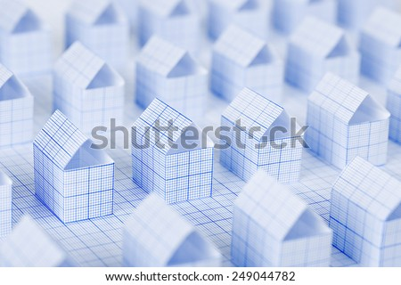 miniature paper houses made with millimeter paper - stock photo
