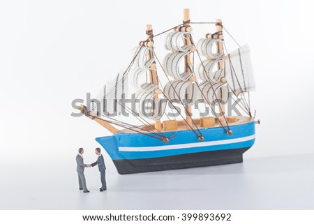 miniature people agreement with sailboat