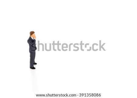 Miniature people businessman isolated on white background - stock photo