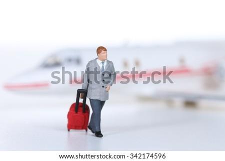 Miniature people on plane - stock photo