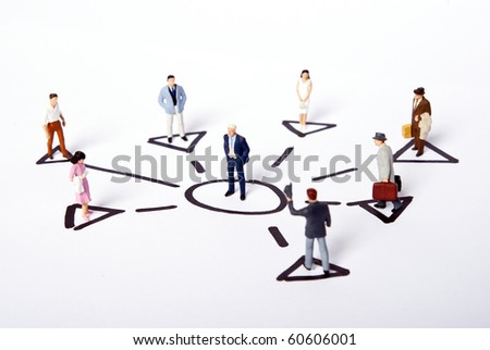 miniature people on team - stock photo