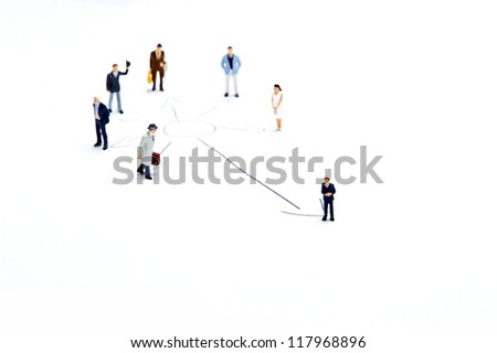 Miniature people on white background - stock photo