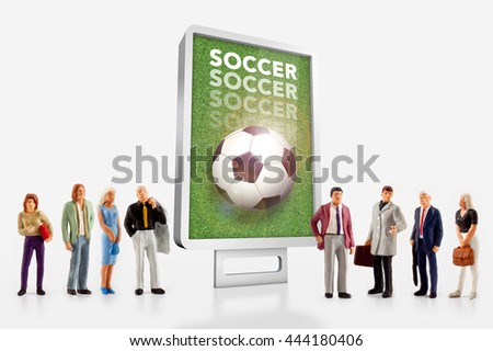 miniature people  - people standing in front of billboard for the soccer