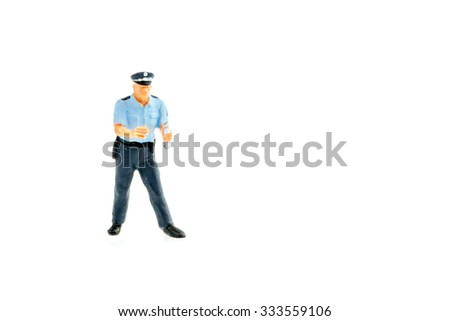 Miniature people safety concept police and thief on white background - stock photo