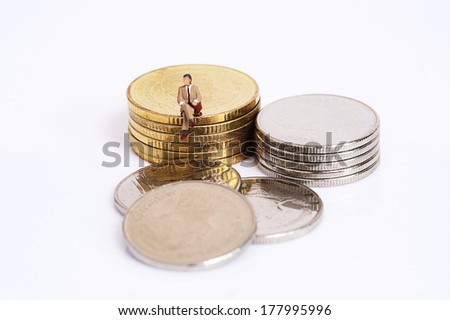 Miniature people with coins - stock photo