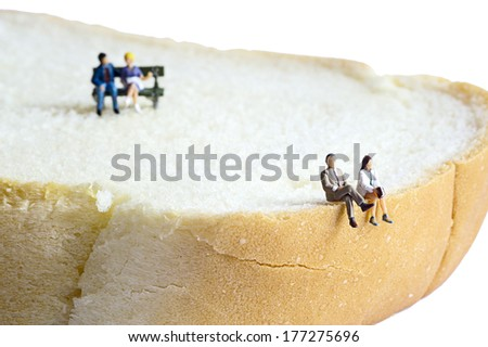 Miniature peoples at leisure - stock photo