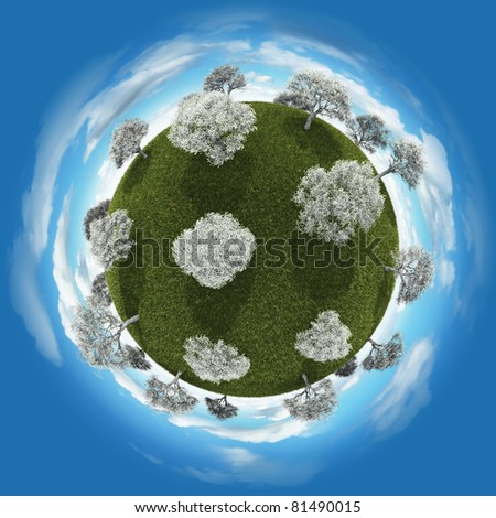 Miniature planet with blossoming trees vegetation and atmosphere with clouds - stock photo