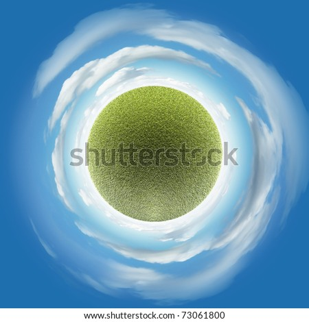 Miniature planet with grass vegetation and atmosphere with clouds - stock photo