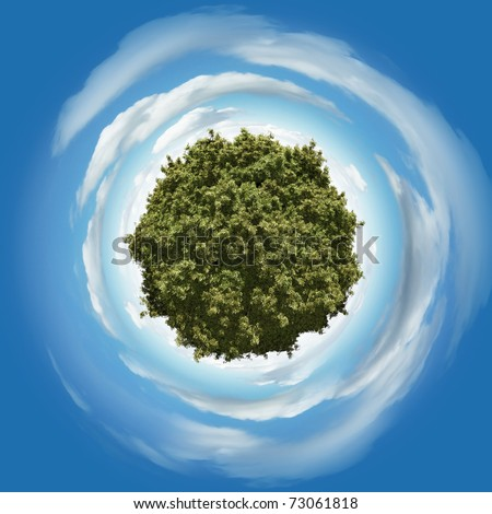 Miniature planet with leafy vegetation and atmosphere with clouds - stock photo