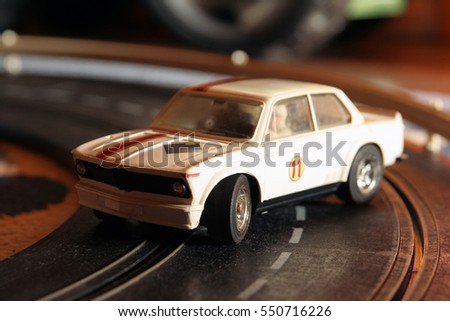 Miniature racing car model. Miniature racing car model. Kids racing car toy.