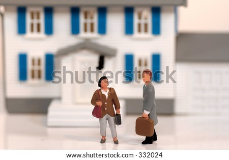 Miniature Realtor and Client - stock photo