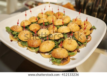 Miniature roast beef sandwiches with cranberries - stock photo